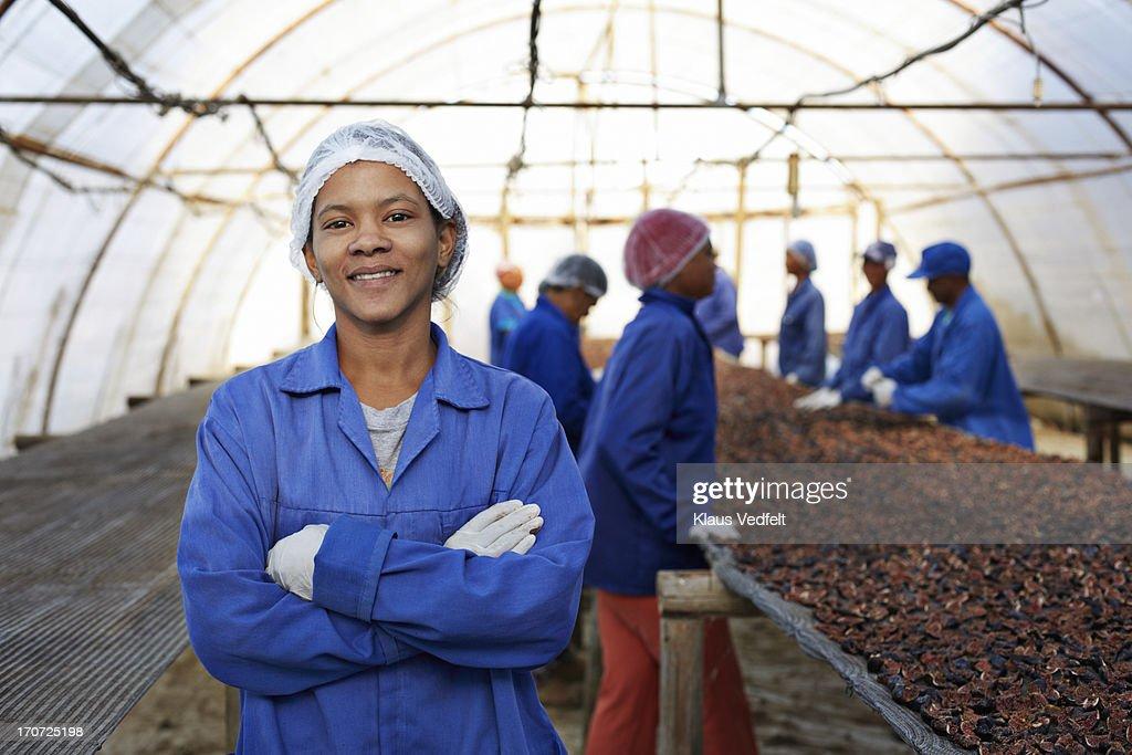 Portrait of proud worker at fruit farm