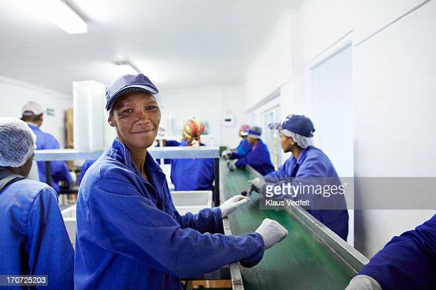 Portrait of proud worker at small fruit factory