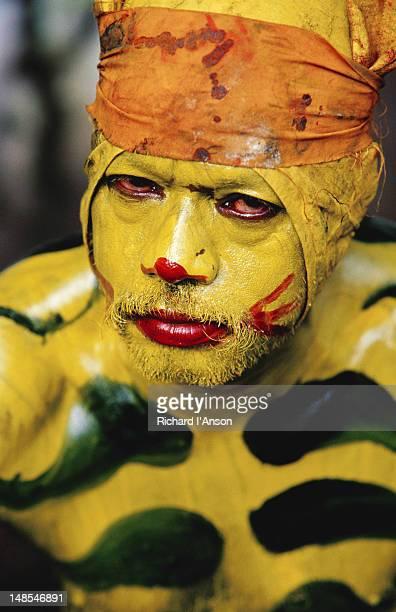 Portrait of Pulikkali (tiger dance) performer at Onam festival celebration.