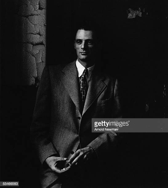 Portrait of Pulitzer and Tony Award winning American playwright Arthur Miller as he leans in shadow and wears a suit and tie Febuary 20 1947 in New...