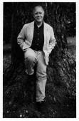 Portrait of Pulitzer Prizewinning American poet and US Poet Laureate Robert Hass as he leans against a tree Berkeley California 1999
