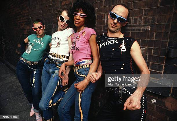 Portrait of 'punk' fashion designers Pam Craig Marsha and Jim as they pose in an assortment of their designs on Staple Street in Tribeca New York New...