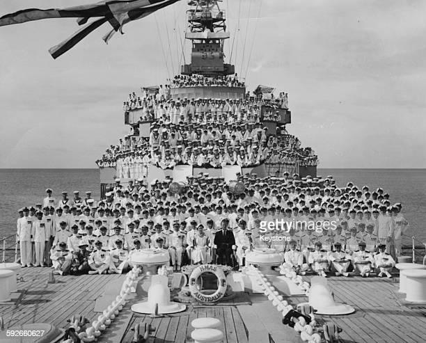 Portrait of Queen Elizabeth II and the Duke of Edinburgh with the crew of the HMAS Australia battlecruiser near Cairns Queensland March 13th 1954