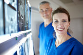 Portrait of radiologists with brain scans