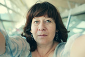 Selfie portrait of beautiful real 45 years old woman