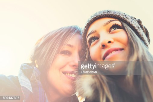Portrait of real teenage daughter with mother