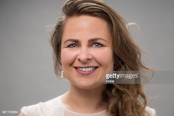 Portrait of real woman, happy with smile