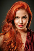 Portrait of red haired woman