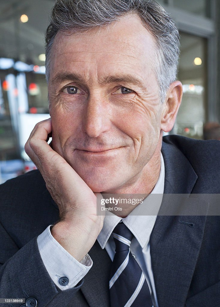 Portrait of relaxed businessman, close-up : Stock Photo