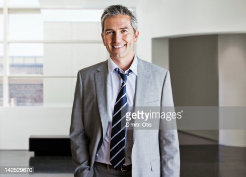 Portrait of relaxed businessman in modern interior : Stock Photo