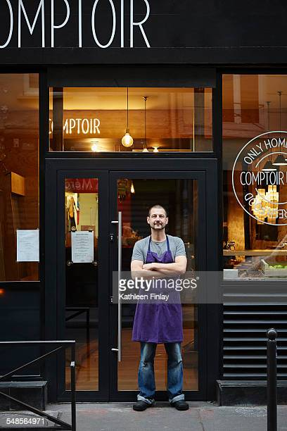Portrait of restaurant owner, outside his business
