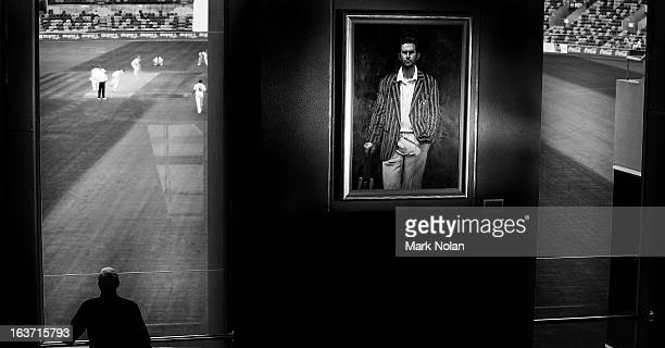 A portrait of Ricky Ponting is displayed in the foyer of the Tasmanian Cricket Museum as a man watches play during day two of the Sheffield Shield...