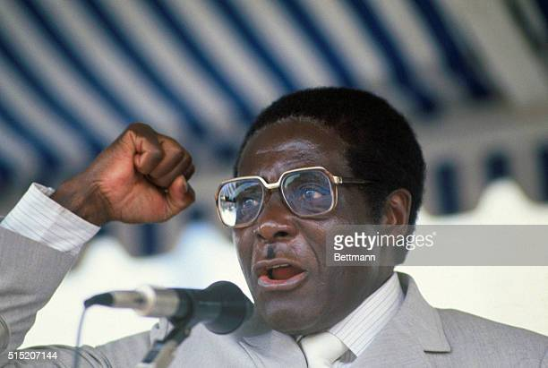 Portrait of Robert Mugabe Prime Minister of Zimbabwe speaking at microphone