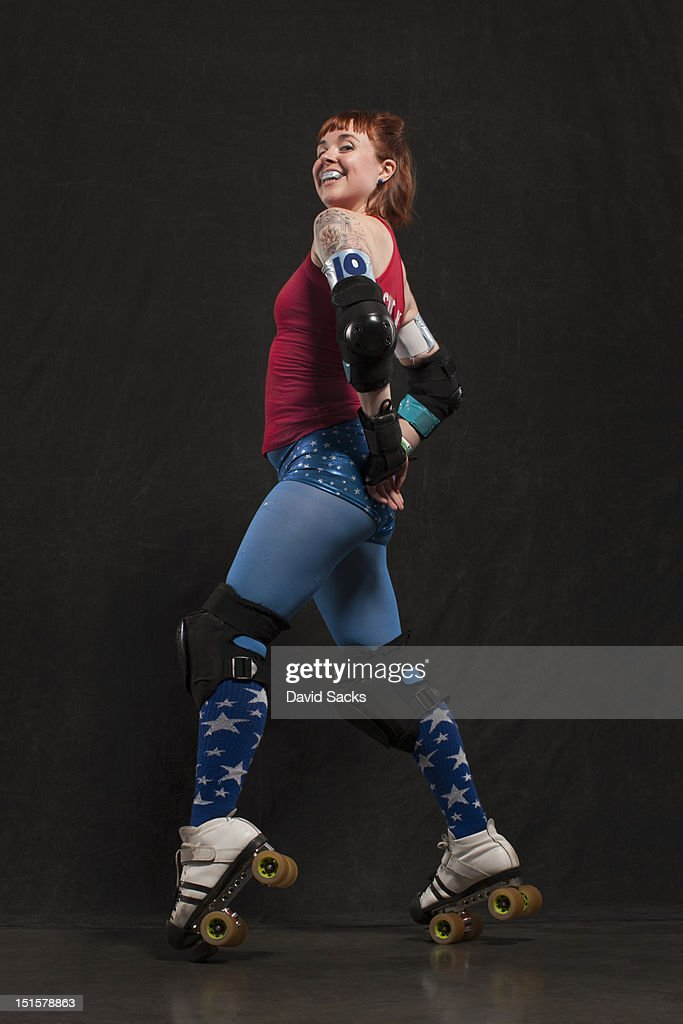 Portrait of roller derby woman in skates : Stock Photo