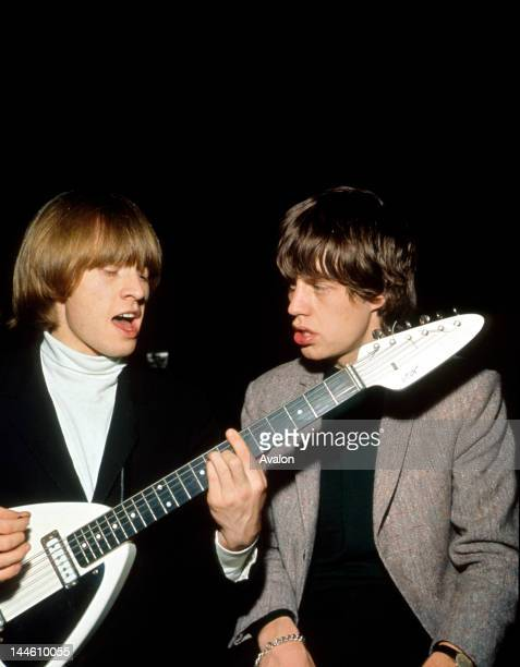 Portrait of Rolling Stones guitarist Brian Jones and singer Mick Jagger photographed in 1966