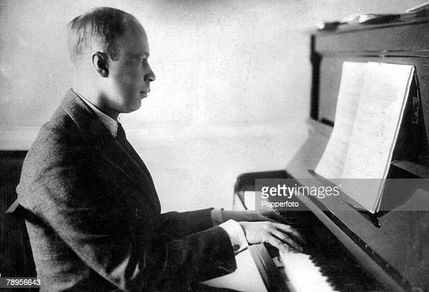 Portrait of Russian composer Serge Prokofiev playing his piano