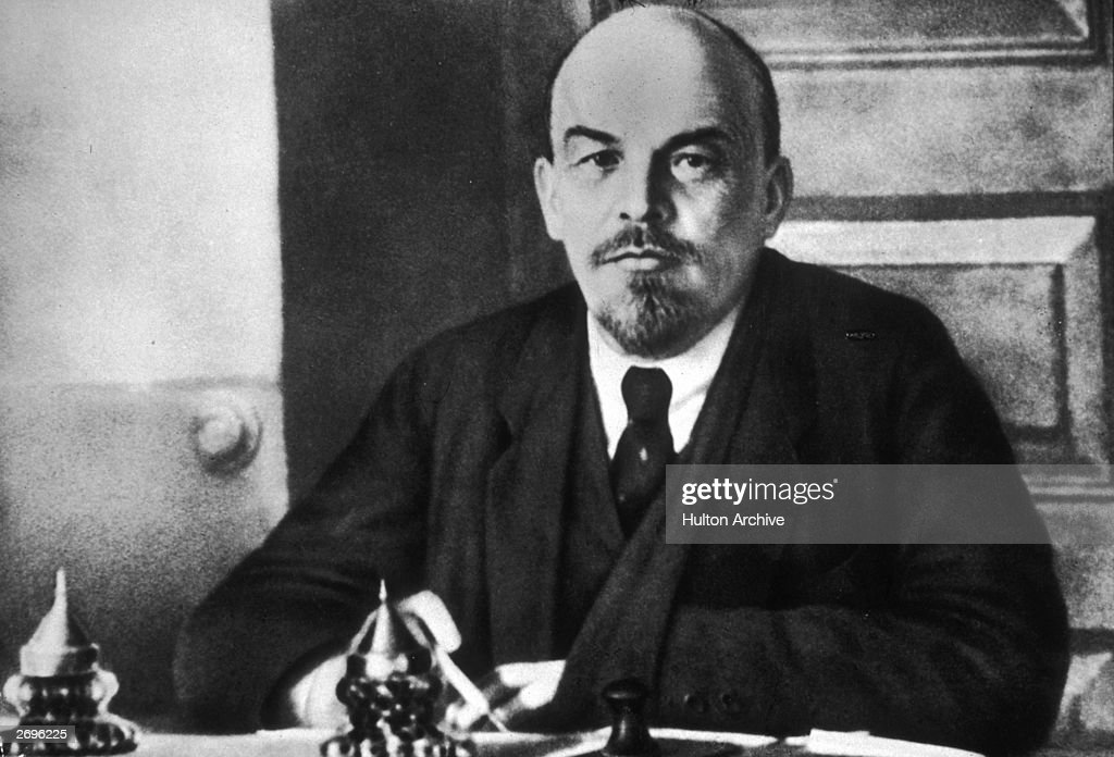 Portrait of Russian revolutionary leader Vladimir Lenin (1870 - 1924) sitting at a table during a meeting of the Sovnarkom. Lenin founded the Bolshevik party.