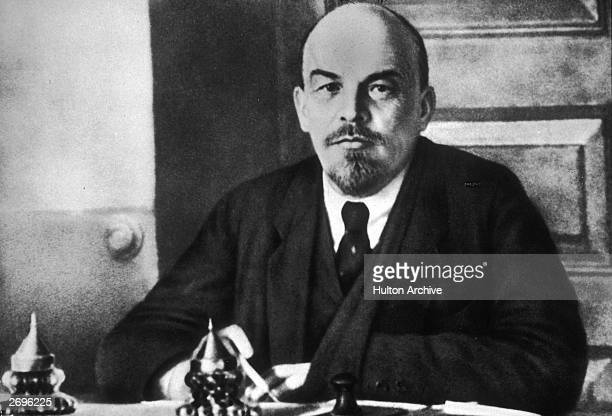 Portrait of Russian revolutionary leader Vladimir Lenin sitting at a table during a meeting of the Sovnarkom Lenin founded the Bolshevik party