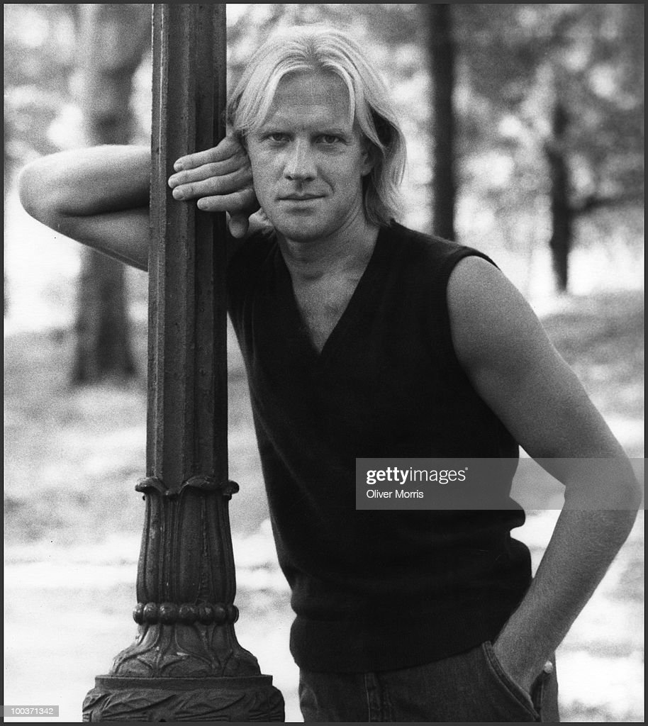 Portrait of Russian-American ballet dancer and actor Alexander Borisovich Godunov (1949 - 1995) as he leans against a lamp post in Central Park, New York, New York, mid 1980s.