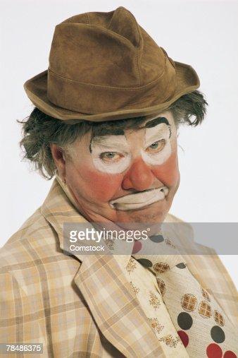 Portrait of sad hobo clown : Stock Photo