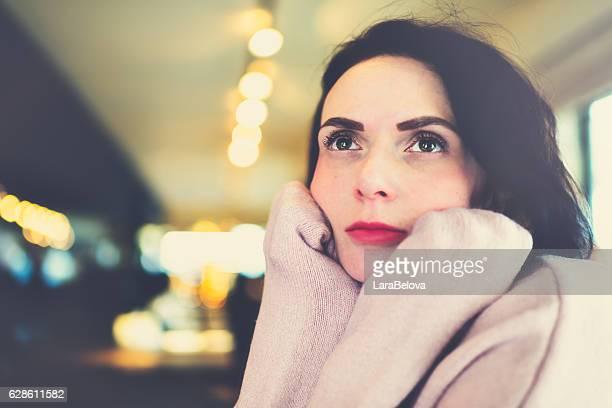 Portrait of sad pensive woman