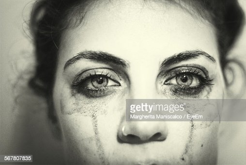 Portrait Of Sad Young Woman With Make-Up Smudged Up