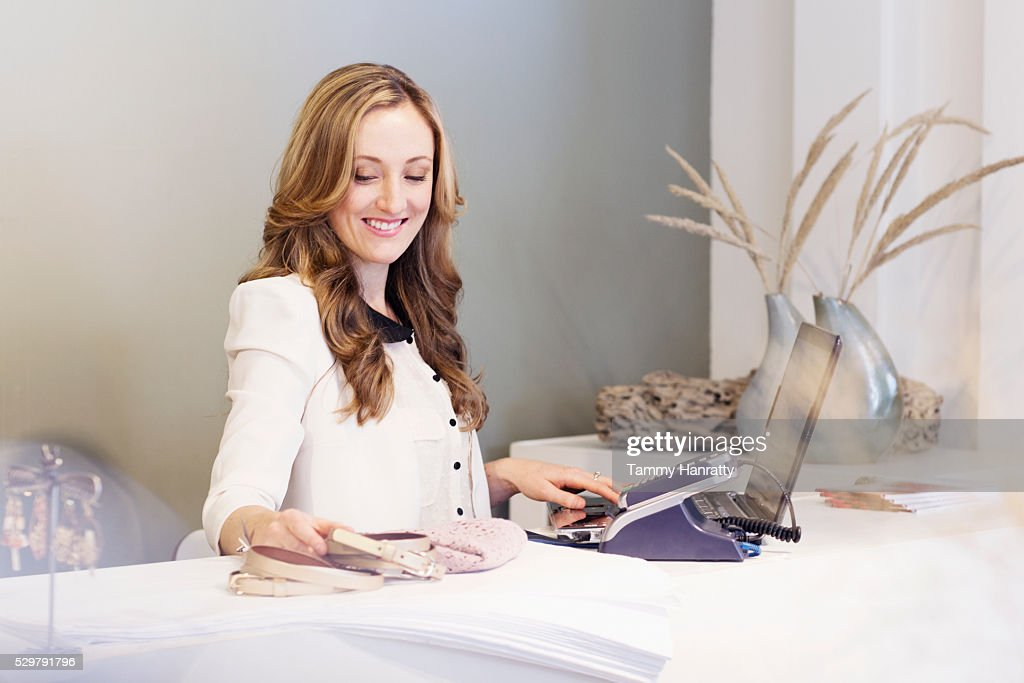 Portrait of sales clerk behind counter : Bildbanksbilder