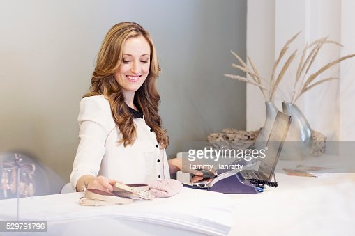 Portrait of sales clerk behind counter : Stock Photo