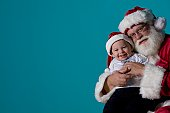 Portrait of Santa with a baby