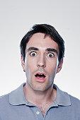 Portrait of scared man, studio shot