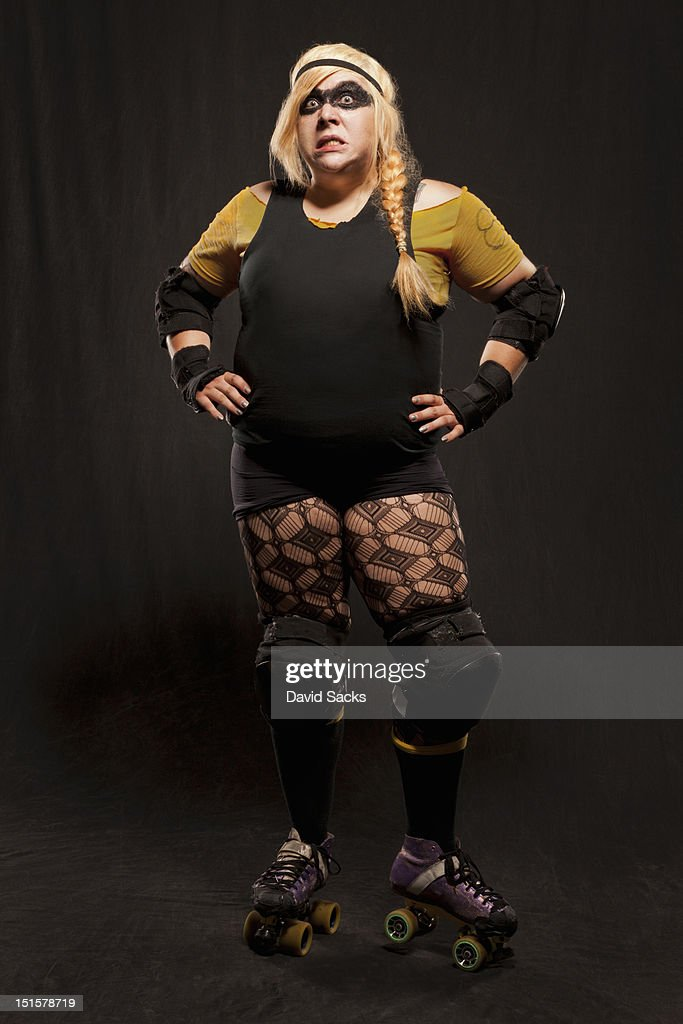 Portrait of scary woman in skates : Stock Photo