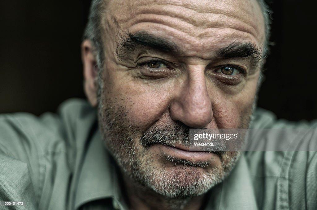 Portrait of sceptical senior man