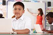 Portrait of school child at laptop