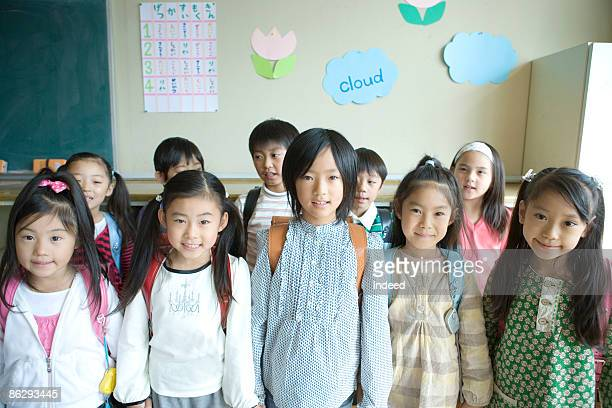 Portrait of school children (6-11) in classroom