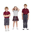 Portrait of school friends standing together over white background