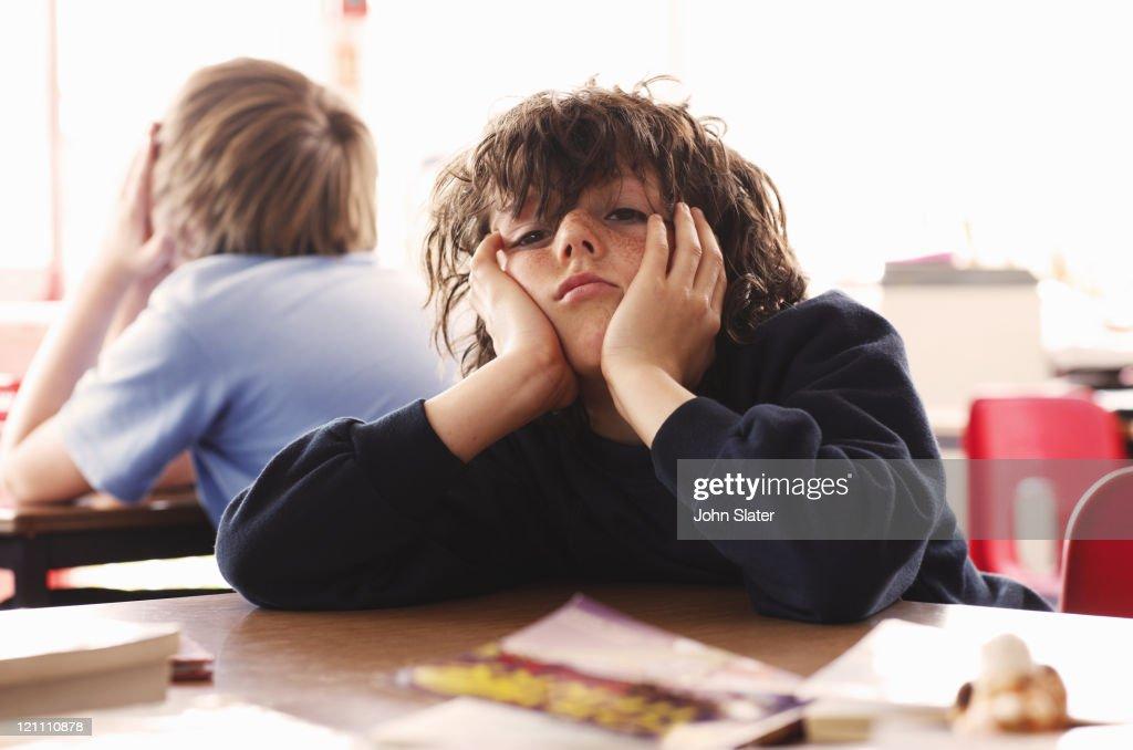 portrait of schoolboy looking bored