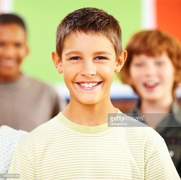 Portrait of schoolboy with his classmates in the background