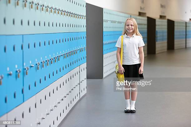 Portrait of schoolgirl in corridor