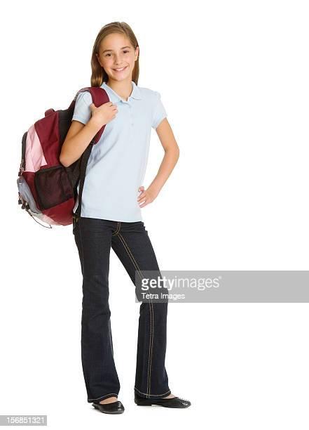 Portrait of schoolgirl (10-11) with backpack, studio shot