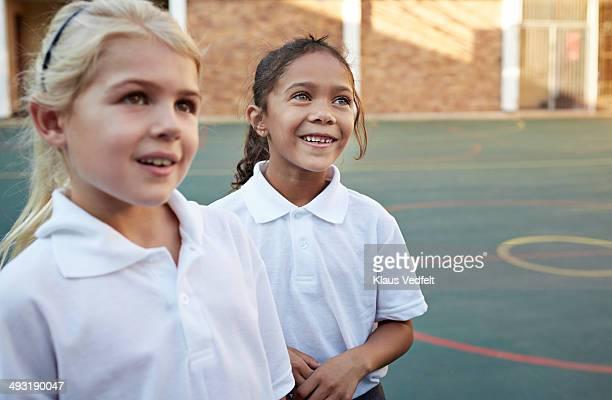 Portrait of schoolgirls in schoolyard