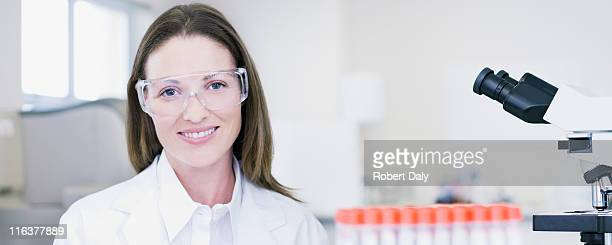 Portrait of scientist wearing goggles in laboratory