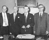 Portrait of Scottish politicians Parliamentary UnderSecretary Robert Hughes Minister of State Lord Hughes Secretary of State Willie Ross and Minister...