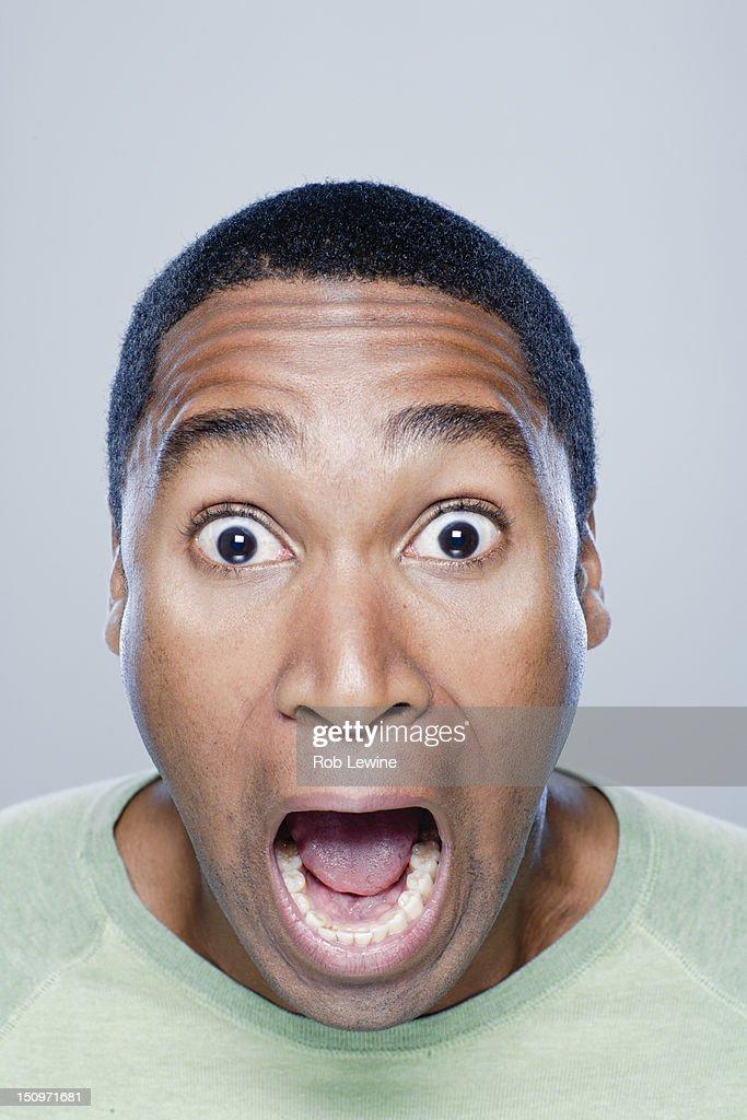 Portrait of screaming young man, studio shot