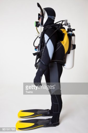 Portrait of scuba diver, side view, studio shot