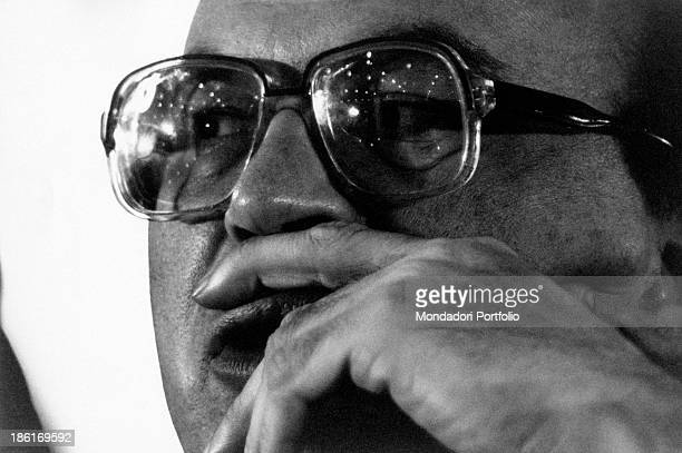 Portrait of Secretary of the Italian Socialist Party Bettino Craxi with his hand on his lips 1980s