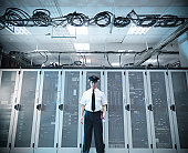 Portrait of security guard wearing uniform in computer server room