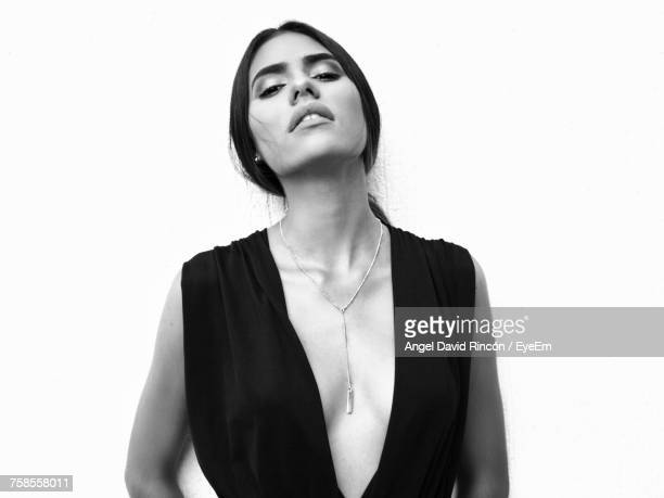 Portrait Of Seductive Woman Standing Over White Background