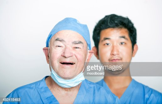 A portrait of Senior adult surgeon and a young  doctor : Stock-Foto