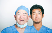 A portrait of Senior adult surgeon and a young  doctor