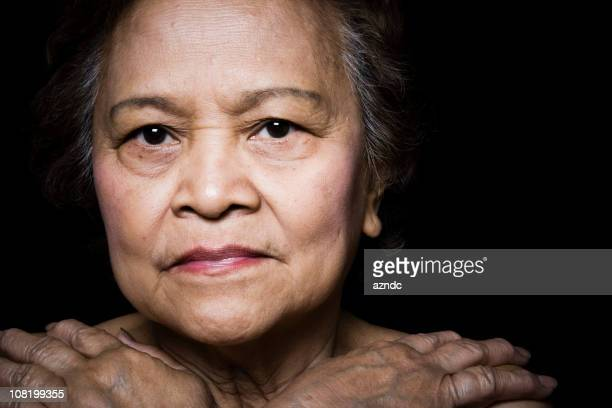 Portrait of Senior Asian Woman on Black Background